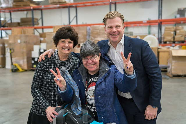 Edwards Center founder Jean Edwards and Fournier Group CEO a Resident at a volunteering event