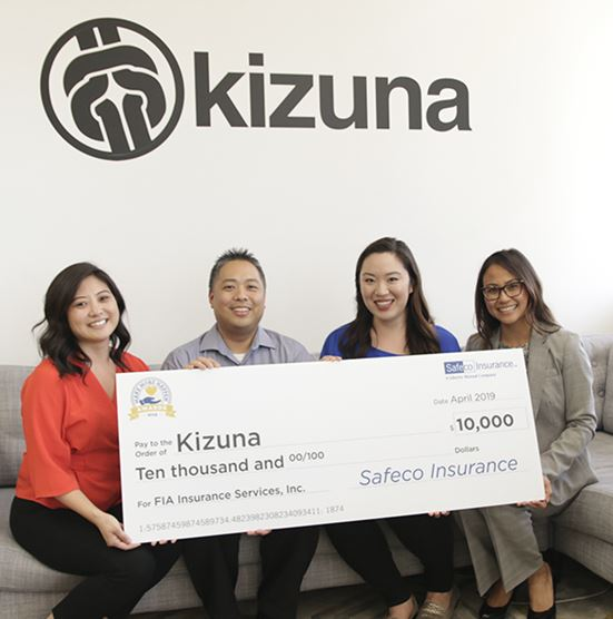 FIA Insurance and Kizuna check presentation